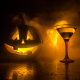 A Jack-o-lantern parties with a cocktail