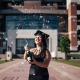 Girl Celebrates Graduation by Popping Champagne