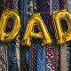 """""""DAD"""" Spelled In Balloons In Front of a Wall of Ties"""